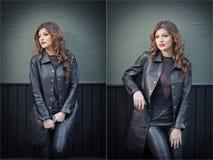 Reizend junge Brunettefrau in der schwarzen ledernen Ausstattung, im Mantel und in der Hose, mit dunkelgrauer Wand auf Hintergrun Stockfoto