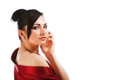 Reizend junge Frau im roten Kleid Stockbilder