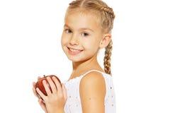 Reizend Mädchen mit einem Apfel stockfotografie