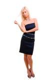 Reizende blonde Frau im Kleid über weißem Hintergrund Lizenzfreie Stockfotografie