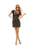Reizende Frau im Kleid Stockbild