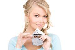 Reizende Frau mit Fonds und Geld Stockfoto