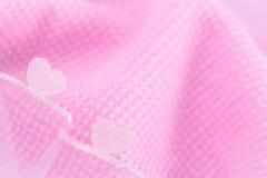 Reizende Herzen auf rosa Hintergrund Lizenzfreies Stockfoto