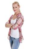 Reizende junge blonde Frau in der beiläufigen Kleidung Stockfotos