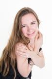 Reizende junge blonde Frau, die auf Weiß aufwirft Lizenzfreies Stockbild