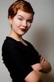 Reizende junge Frau mit Dollarzeichen auf Gesicht lizenzfreies stockfoto