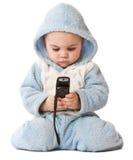 Reizender kleiner Junge mit Telefon Stockbild