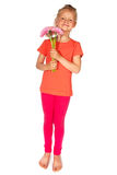 Reizendes blondes Mädchen mit Blumen Stockfoto