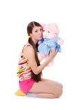 Reizendes junges Mädchen mit einem Spielzeug Lizenzfreie Stockfotos