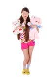 Reizendes junges Mädchen mit Spielwaren stockfotos
