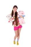 Reizendes junges Mädchen mit Spielwaren Lizenzfreies Stockbild
