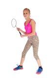 Reizendes junges Mädchen mit Tennisschläger Stockbild