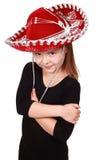 Reizendes kleines Mädchen in einem roten Cowboyhut Lizenzfreies Stockfoto