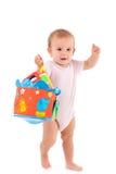 Reizendes Kleinkind, das in der Hand Spielzeug anhält Stockfoto