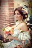 Reizendes Mädchen mit Blumen Lizenzfreie Stockbilder