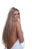 Reizvolle blonde Frau im weißen Kleid Stockfotos