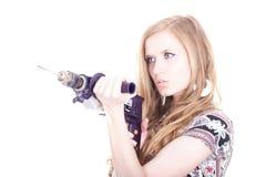 Reizvolle Dame mit einem Bohrgerät Stockfotografie