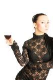 Reizvolle Dame mit einem Glas Rotwein Stockfotografie