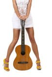 Reizvolle Fahrwerkbeine und Gitarre Lizenzfreies Stockfoto