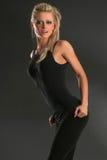 Reizvolle Frau in der Trainingsoberseite Lizenzfreie Stockbilder