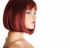 Reizvolle Frau des Portraits mit dem roten Haar Stockfoto