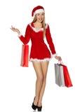 Reizvolle Frau, die Weihnachtsmann-Kostüm trägt stockfoto