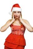Reizvolle Frau gekleidet als Weihnachtsmann stockfotos