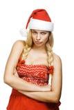 Reizvolle Frau gekleidet als Weihnachtsmann stockbild