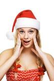 Reizvolle Frau gekleidet als Weihnachtsmann stockbilder