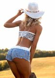 Reizvolle Frau im Cowboyhut Stockfotos