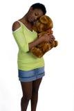 Reizvolle Frau und Teddybär Stockbilder