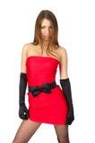 Reizvolle Frau in wenigem rotem Kleid Stockbild
