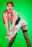 Reizvolle Frauenholding gesprengt durch Windkleid lizenzfreie stockbilder