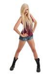 Reizvolle junge blonde Frau in den Denimkurzschlüssen Lizenzfreies Stockbild