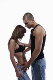 Reizvolle junge Paare in den Jeans Lizenzfreie Stockbilder