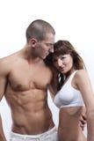 Reizvolle junge Paare im Weiß Stockfotografie