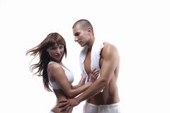 Reizvolle junge Paare im Weiß Stockbild