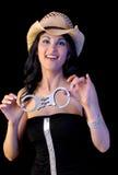 Reizvolle Mädchen-Holding-Handschellen Stockfoto