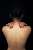 Reizvolle Rückseite der jungen Frau Stockfotos