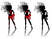 Reizvolle Schattenbild-Frauen, die Rot-Bögen tragen Lizenzfreie Stockfotos