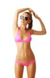 Reizvolle tan Frau im Bikini Lizenzfreie Stockfotografie