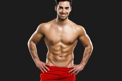 Reizvoller muskulöser Mann Stockfoto