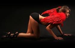 Reizvoller roter Engel Stockfoto