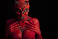 Reizvoller roter Teufel. Stockfotos