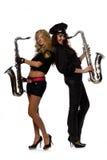 Reizvoller Sicherheitsbeamte mit Saxophon Lizenzfreie Stockfotografie