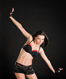 Reizvoller Tänzer auf schwarzem Hintergrund Stockfotografie