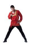 Reizvoller Tänzer im russischen Kostüm getrennt Stockfotografie