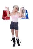 Reizvolles junges blondes Mädchen mit dem Einkaufen Lizenzfreies Stockbild
