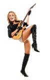 Reizvolles Mädchen, das elektrische Gitarre spielt Lizenzfreie Stockfotos