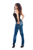 Reizvolles Mädchen in den Jeans Stockfotografie